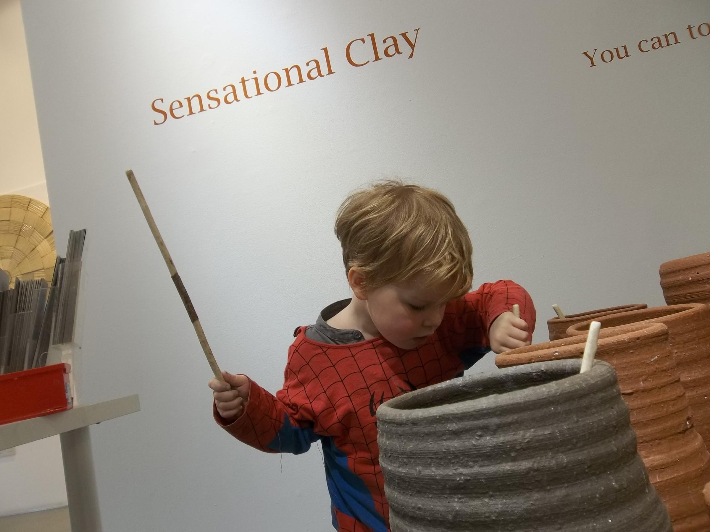 An inquisitive youngster investigates Sensational Clay