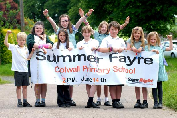 ON THE MOVE: Pupils pictured earlier this year advertising their school fete