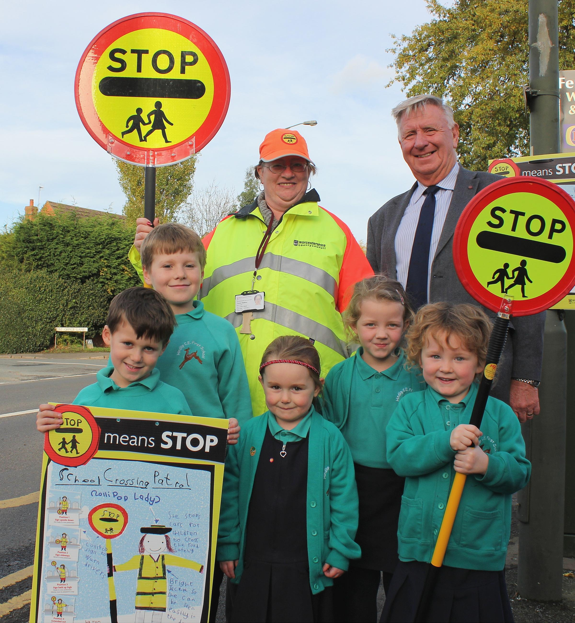 Cllr John Smith OBE, County Council Cabinet Member joins Hindlip CE First School's School Crossing Patrol, Tracey Daultrey, and pupils (from left) Edward, Benjamin, Erin,  Beth and Holly. during last year's National Road Safety Week.