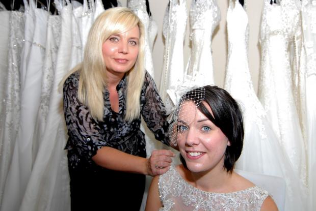 Evesham Journal: Lauren Hirons, winner of a £1,000 wedding dress, has a tiara fitted by Suzanne Bacon-Lewis at Bridal Boutique, Lowesmoor. Picture by Nick Toogood 2114606704.