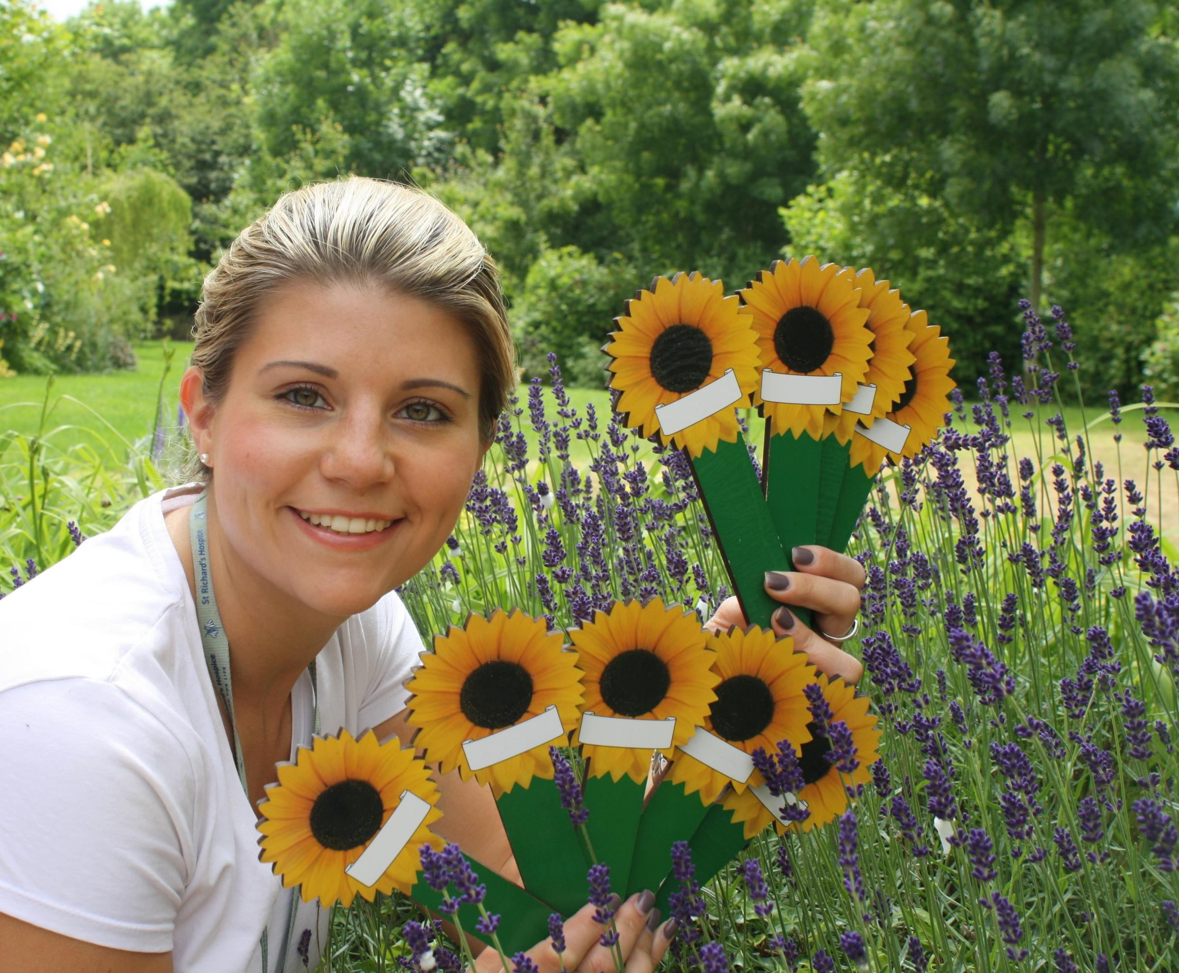 Remembering loved ones: Lizzie Brazier with the sunflowers (s)