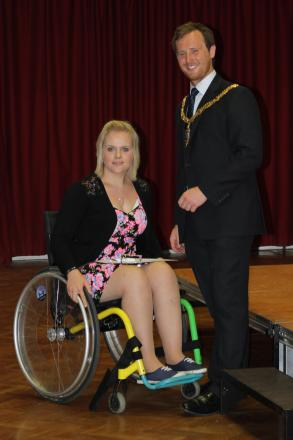 Liz Grinnell receives her Martin Davey Jubilee Award for Sports Leadership and the Royal British Legion Community Service Award from Mayor and ex-student Charlie Homer.