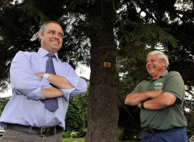 Evesham Journal: Malvern Town Council operations manager Charles Porter and parks supervisor Tony Kiesslinger look at some of the trees in Priory Park that are marked for the Name the Tree competition for this year's Malvern in Bloom. Picture by John Anyon. 2914645601