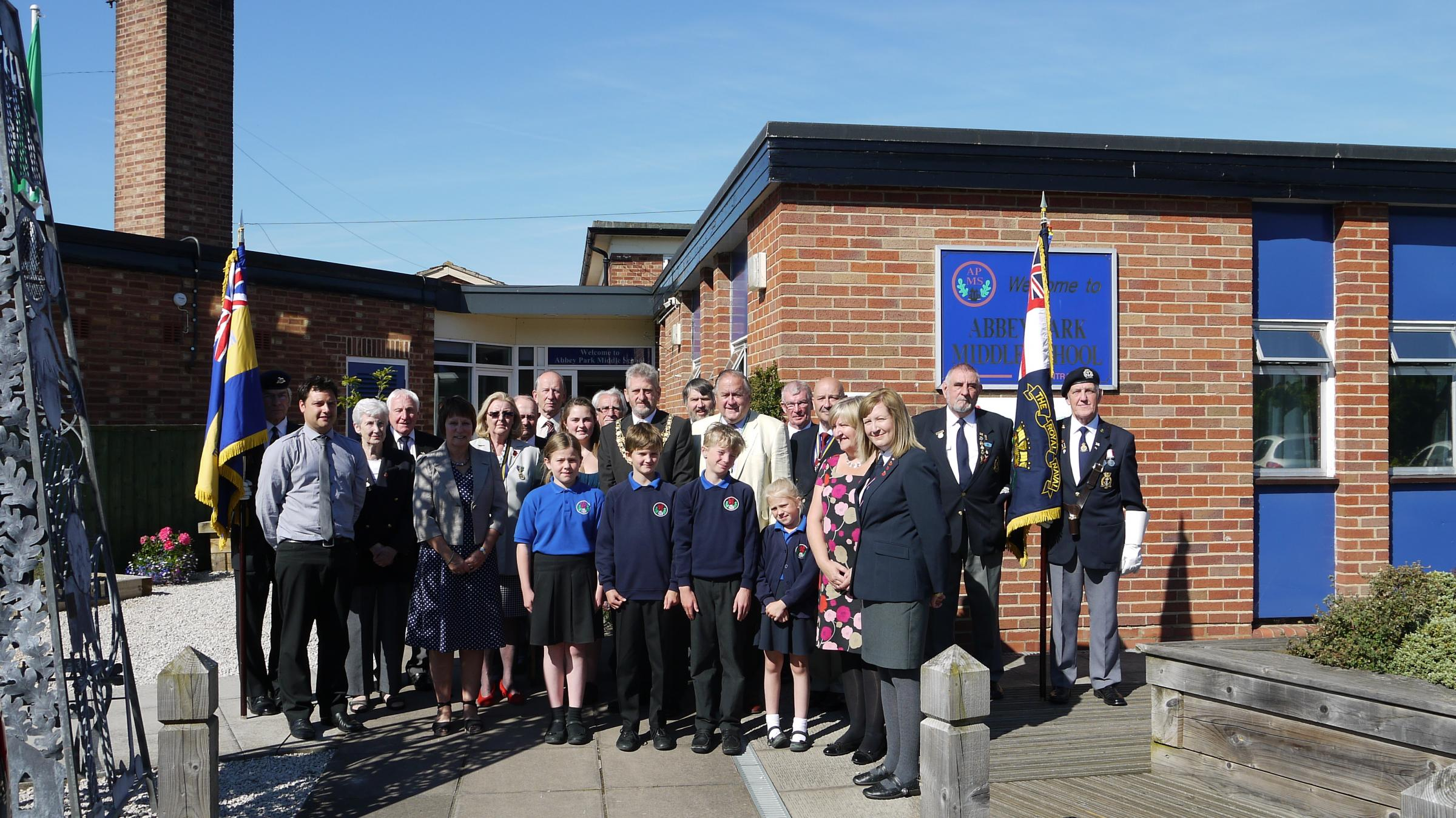 Trudy Burge (front right) at Abbey Park Middle School earlier this month (July) marking the centenary with children and veterans from the Pershore & District Branch Royal British Legion & Royal Naval Association.