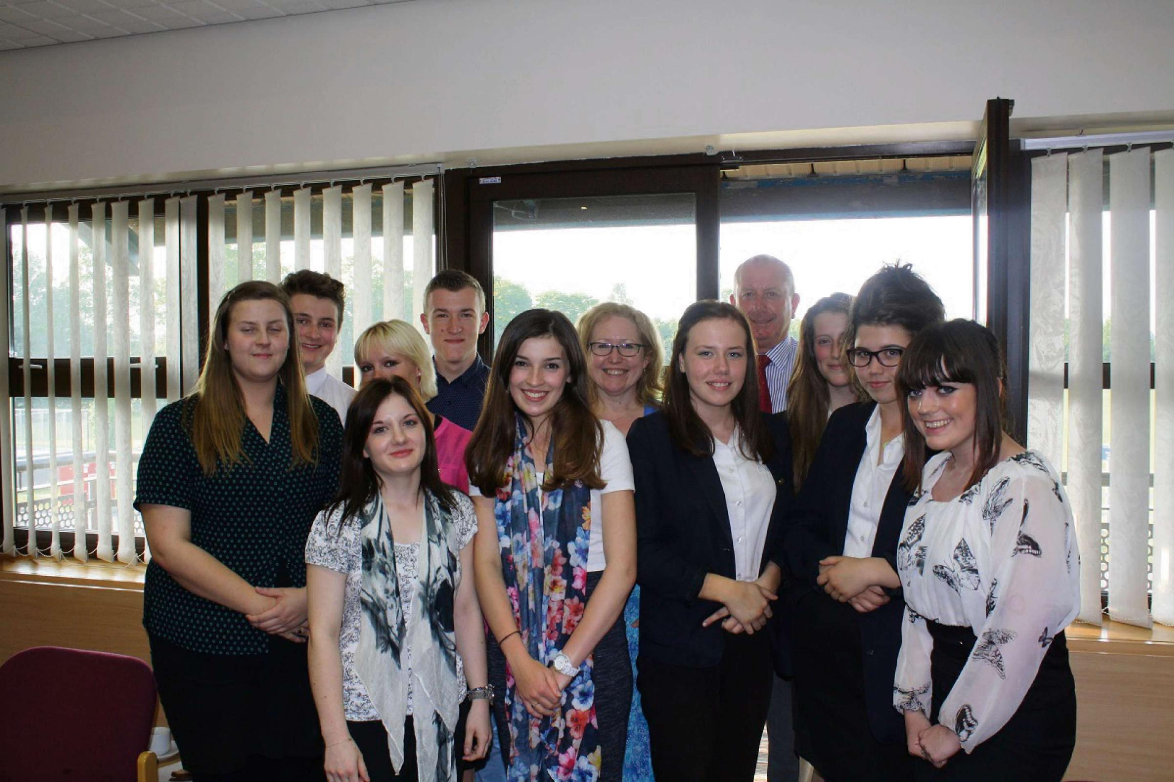 Members of Worcestershire Health and Care NHS Trust's youth board celebrate their first anniversary with chief executive Sarah