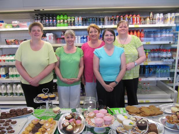 CAKE SALE SUCCESS: From left - Barb Taylor, Jackie Hammerton, Lyn Dyke, Christine Sawyer, Glen Taylor.