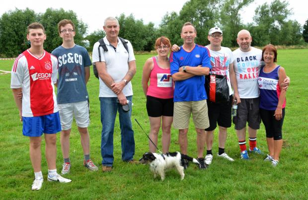 Evesham Journal: FUNDRAISERS: Robin Clarke (fourth from right) who walked the 10K with his wife, his son Matt (left) and the other men pictured. Barbara Pugh (right) and Angela Gittus (next to Robin) organised the event which raised more than £1,600 for charity.