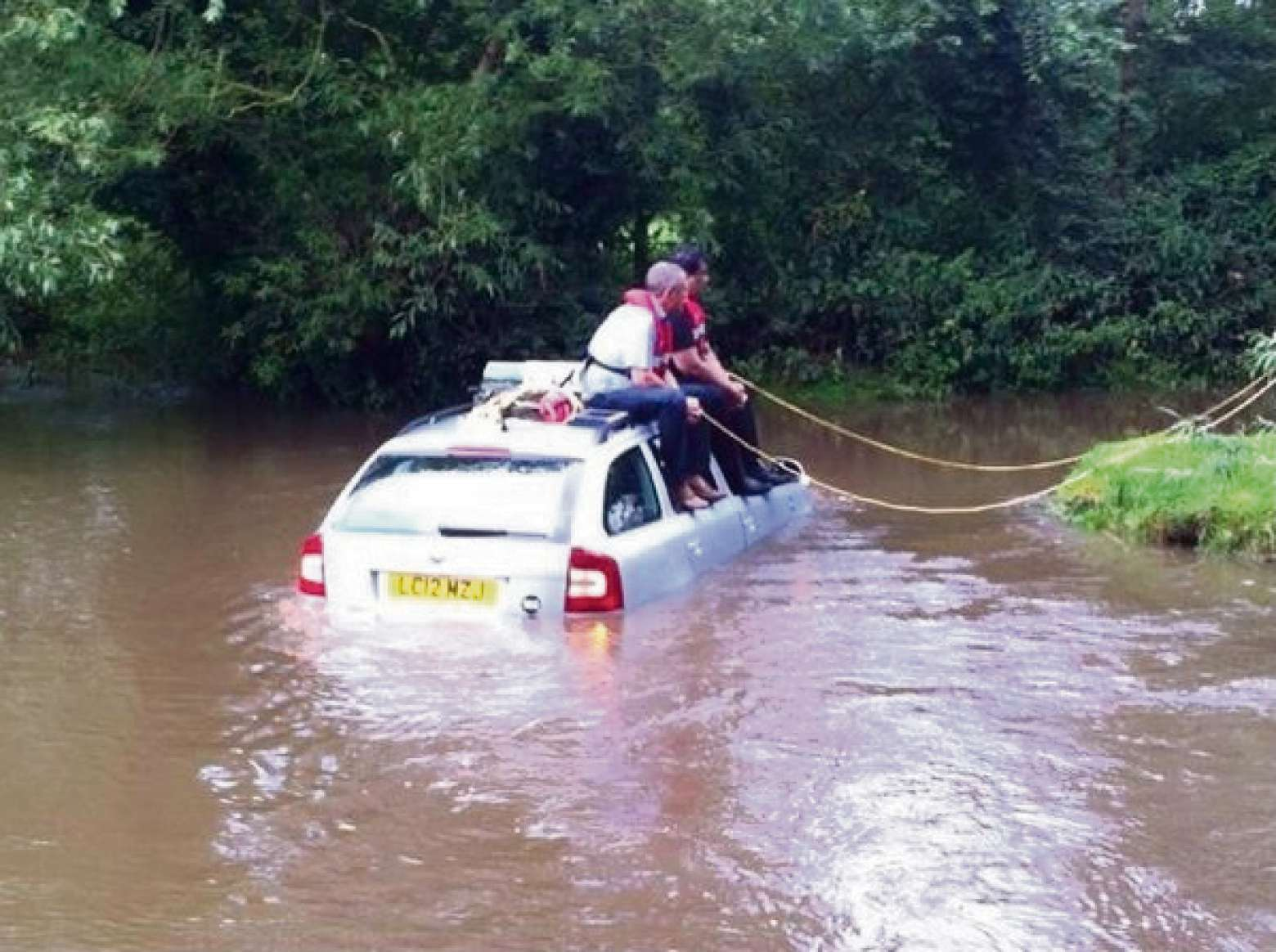 Car rescued from flooded ford
