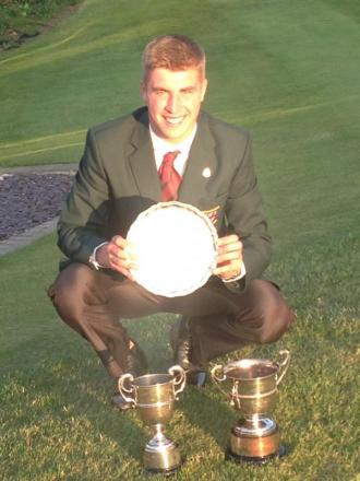 GLITTERING PRIZES: Evesham in-form golfer Oliver Farrell shows off his haul from  the Midland Youths Championship.
