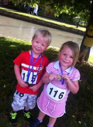 FUTURE STARS: Bourton Roadrunners' twins Robbie and Daisy Reeve proudly display their fun run medals at the Bourton One Mile Challenge. Picture: CLAIRE HARRISON.