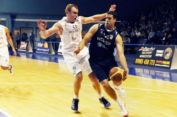 DONATAS VISOCKIS: Worcester's new 6ft 10ins centre, pictured playing against Wolves, and new team-mate Jamal Williams, last season.