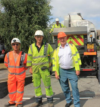 JOB DONE: Highways workers David Smith, left, and David Thacker with Cllr John Smith, cabinet member for highways.