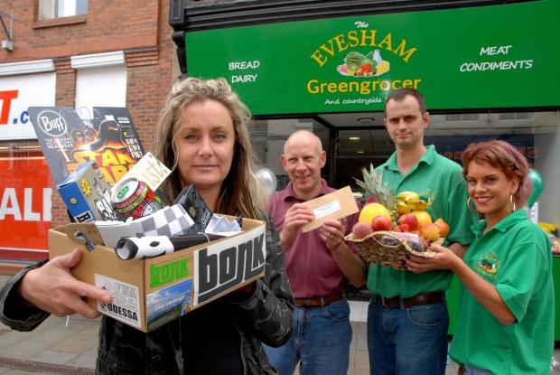 3214668601 Paul Jackson 05.08.14 Evesham - Prize draw prizes for Evesham Loyalty Card. From left - Kim Dunn, owner Bonk, Dave Purser, owner Master Butchers, Robert Bowers, owner Evesham Greengrocers and Roxanne Hatton, sales assistant Evesham Green Grocer
