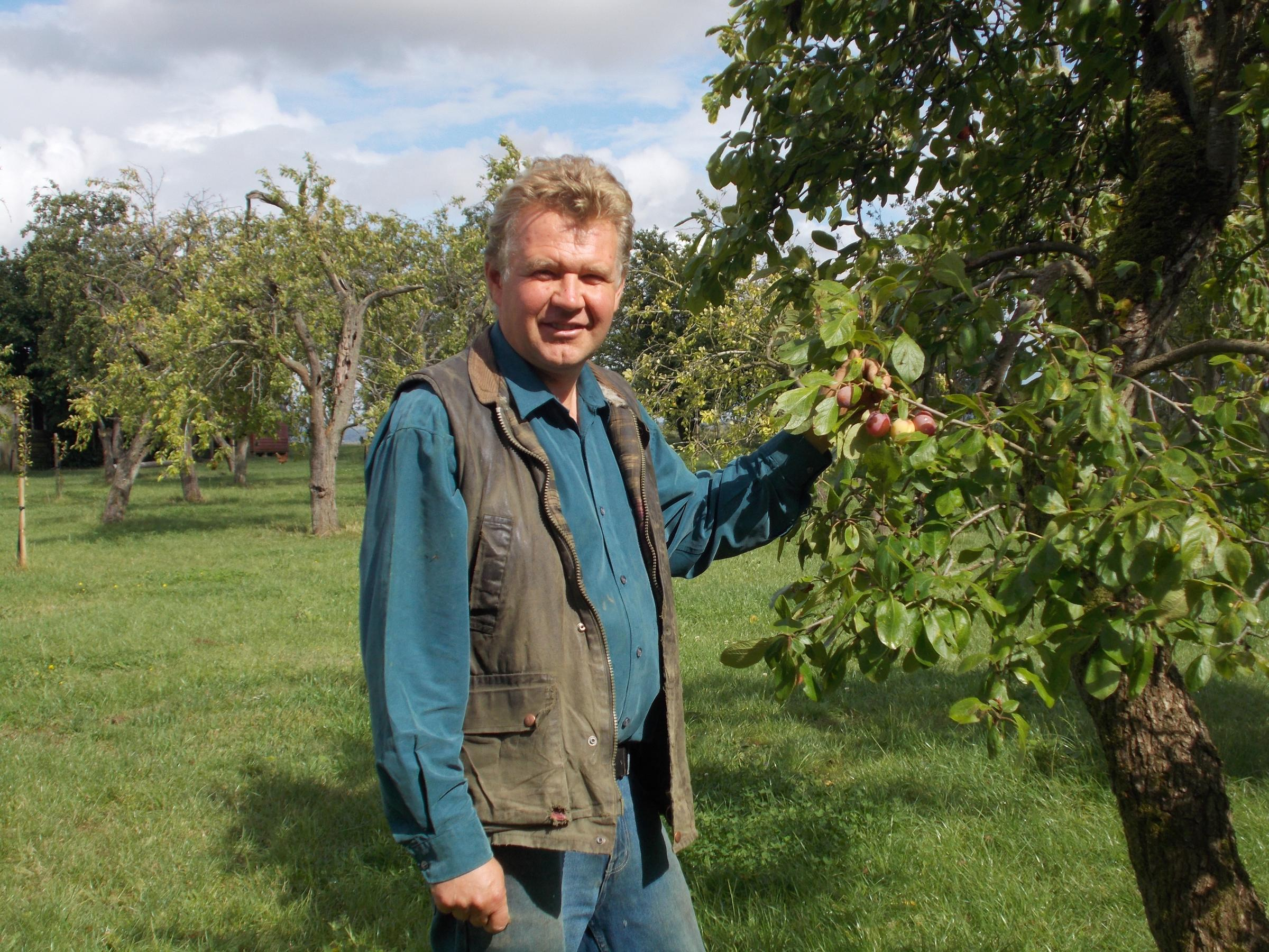 Stuart Nightingale with some plums that survived the hail storm.