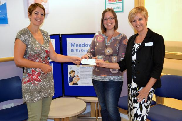 Helen Hunt and Jo Lederer presenting Karen Kokoska with their donation.