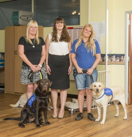 FLOORED: Rita Howson (left), chief executive of Support Dogs, Kate Drew, international marketing co-ordinator, Karndean Designflooring and Joanne Ellam, trainer from Support Dogs with Rollo and Cassie.