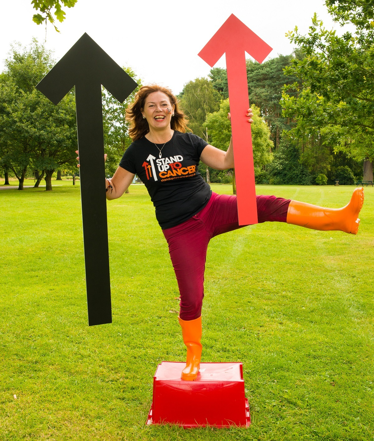 Worcestershire Cancer Research UK press officer Jane Redman poses with the Stand Up To Cancer arrows to point people in the di