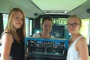 ON BOARD: Nicole Merchant, 12, Chloe Weston, 15 and Madi Rouse, 12 with the music equipment.