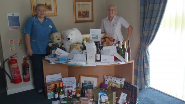 Staff with some of the raffle prizes donated by local businesses.