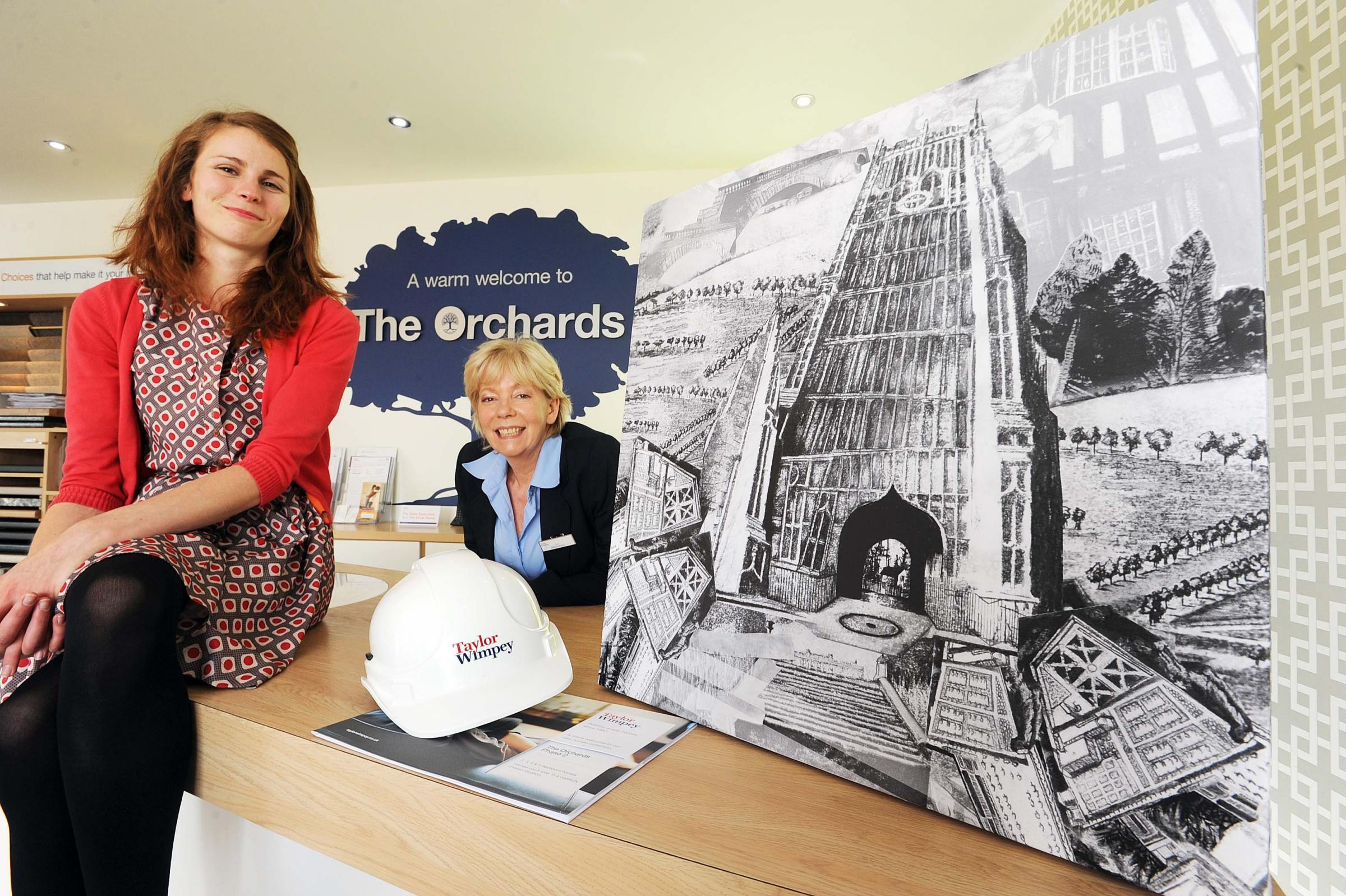 Artist Kitty Kovacevic (left) with Taylor Wimpey Sales Executive Sue Viner (right), at Taylor Wimpey's The Orchards development in Evesham.
