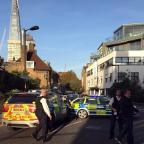Evesham Journal: Police at the scene where a teenager was stabbed to death in south London