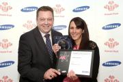 Kerry Harkins receives her Prince's Trust Enterprise award from Royal Bank of Scotland's Mark Round.