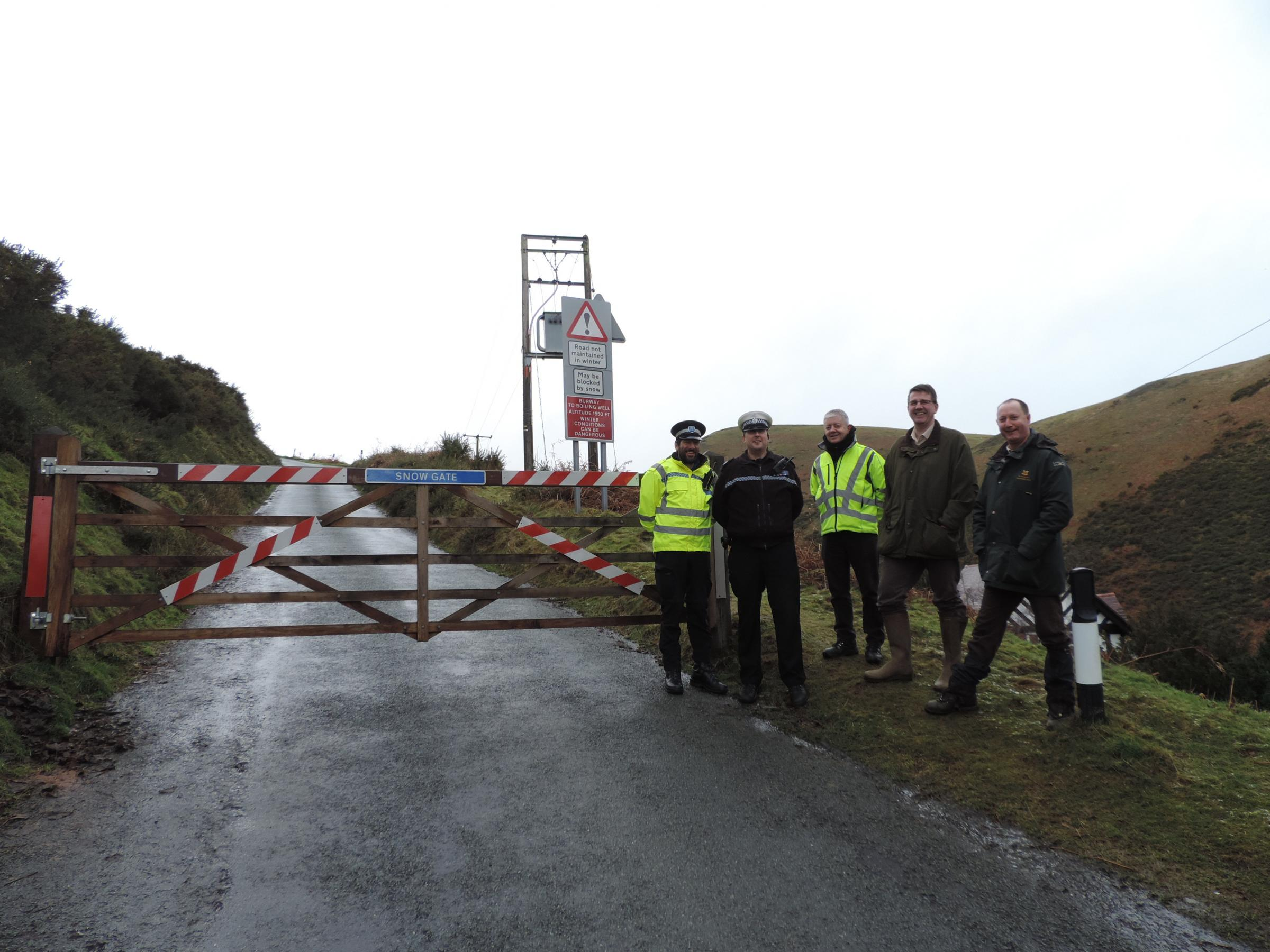 With the new snow gate from left are: Lee Chapman, county councillor; Damon Preston and Dave Baron from the West Mercia Police local team; Chris Jackson from Shropshire County Highways Department; and Dave Cowell, area ranger from the National Trust. Pict
