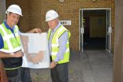 MILESTONE: Gavin Hobbs, site supervisor at William Gough and Sons, and hospital trust chairman Harry Turner look at the plans for the new breast unit.