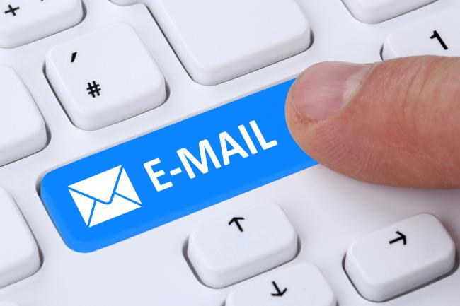 Sending E-Mail mail message by pushing button on computer keyboard with letter symbol (34782411)