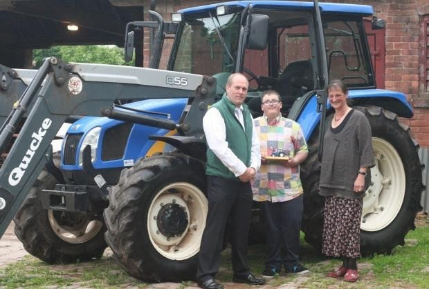 Trevor Scruton, senior tutor at Longlands Care Farm and chief executive Julia Evans with Longlands student Joel Wright.