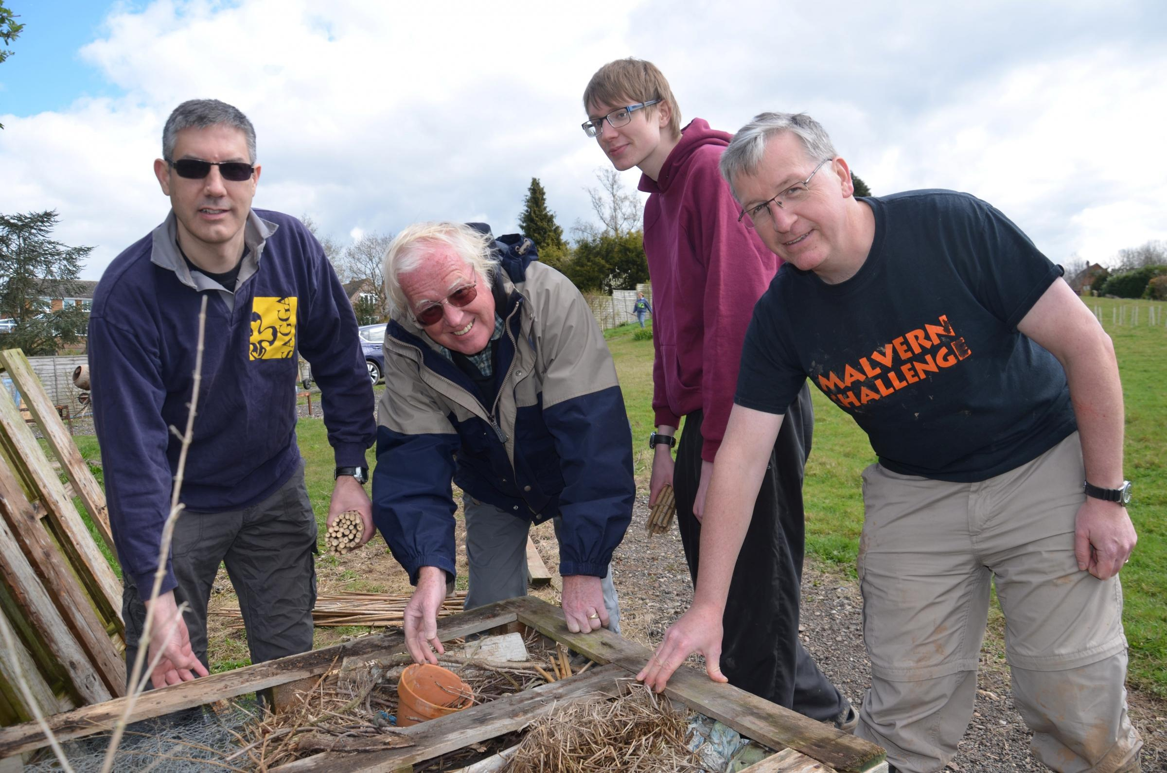 District explorer scout commissioner for Redditch Jonathan Payne, past President of SAGGA Paul Haigh from Cheltenham, explorer scout Adam Payne and scout leader Andy Harding from Burton-on-Trent helping to reconstruct the bug hotel at Nash's Acre.