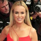 Evesham Journal: Amanda Holden lies naked on a bed of cabbages for Peta