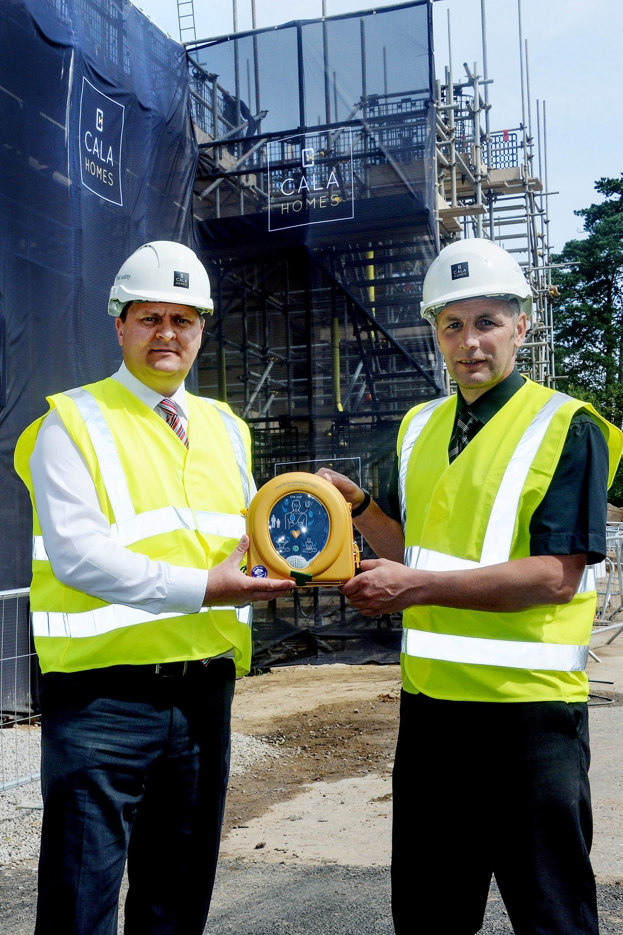 HEART: CALA's Stuart Hosegood, group health & safety director (left) with site manager Martin Dawes (right) and one of the new defibrillators.