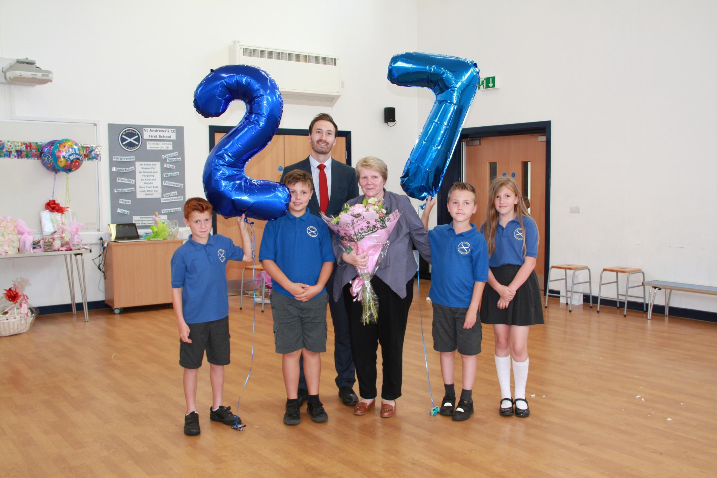 RETIRING: Mary Daffurn, who is retiring from her roles at St Andrew's CE School. Pictures with headteacher Adam Spencer, and pupils Harry Tustin, Jake Kinnersley, Kyle Sadler and Daisy-Mae Murray.