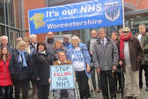 Campaigners from It's Our NHS Worcestershire outside the meeting in Bromsgrove, Parkside