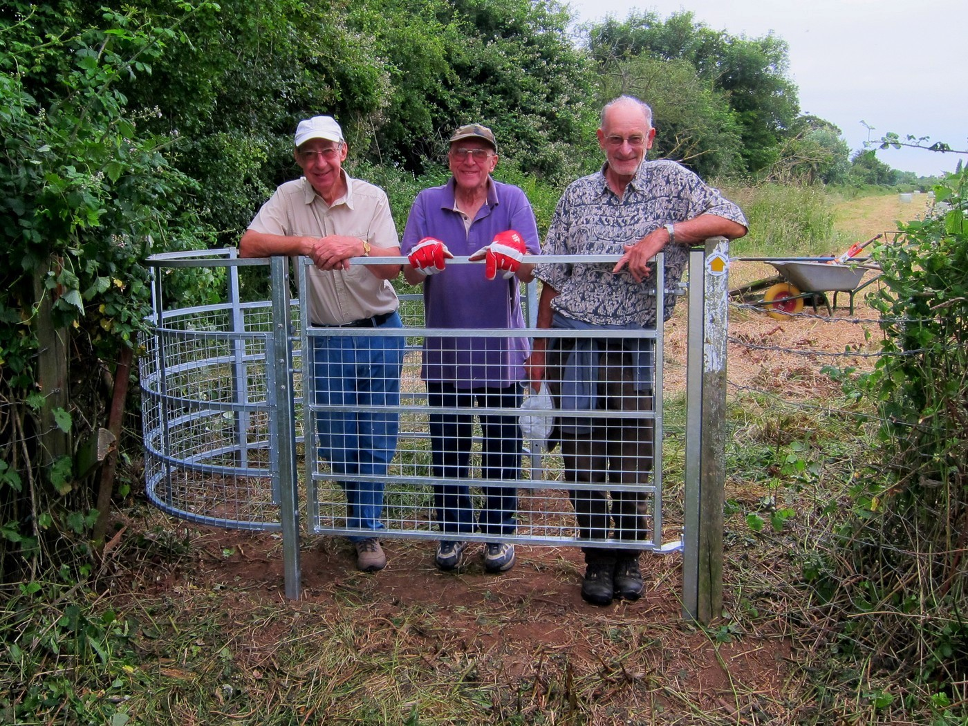 Geoff Smith, Ken Sefton and Paul Jennings with one of the new gates