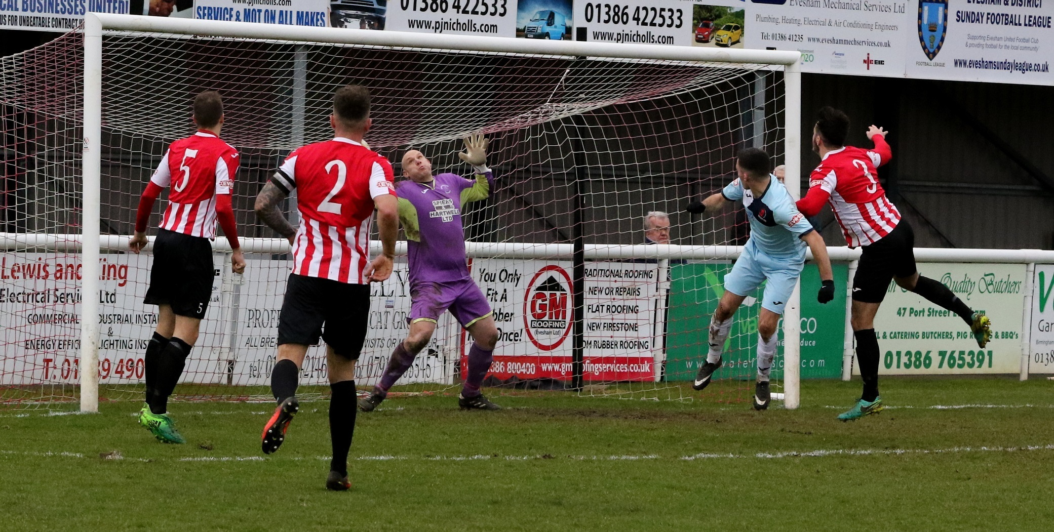 TOUGH DAY: Former Evesham United target Ben Whitehead (9) scored a hat-trick against the Robins on Saturday. (Picture: Steve Rolfe)