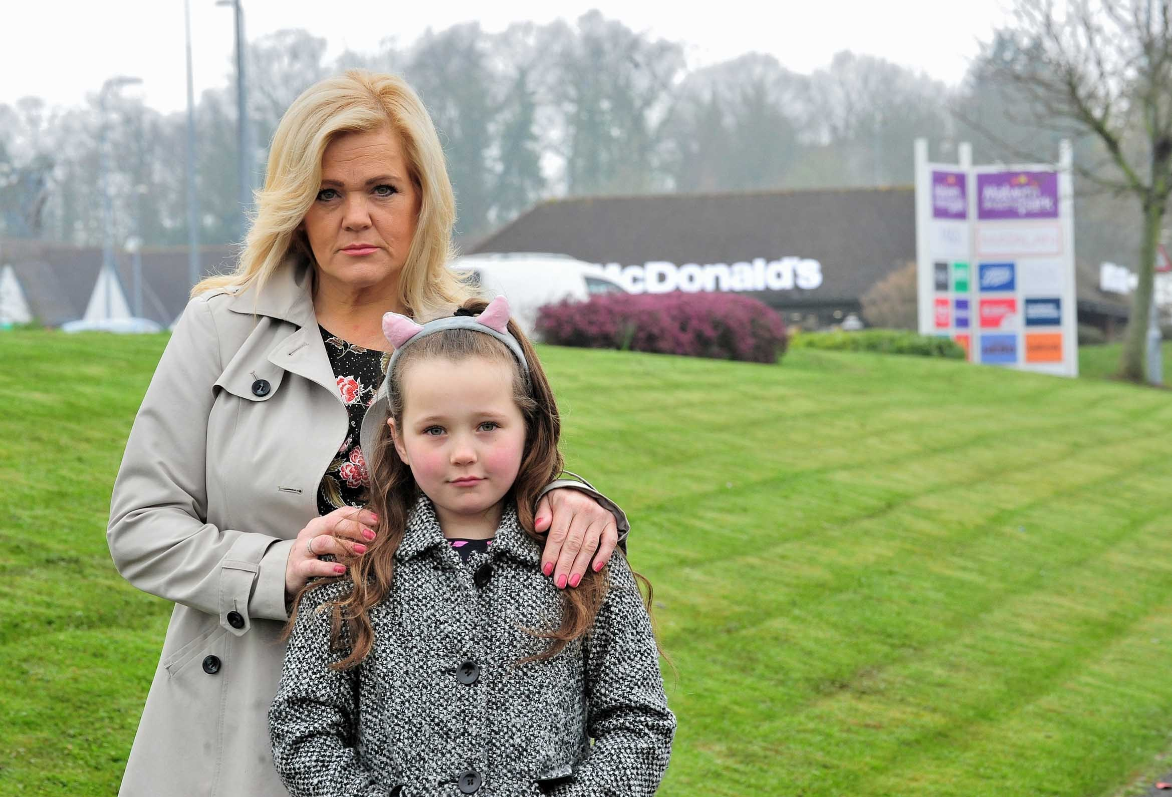 SHOCKED: Caroline Beard, who is calling for security at McDonald's, with her daughter, Isabelle, at Malvern Shopping Park.