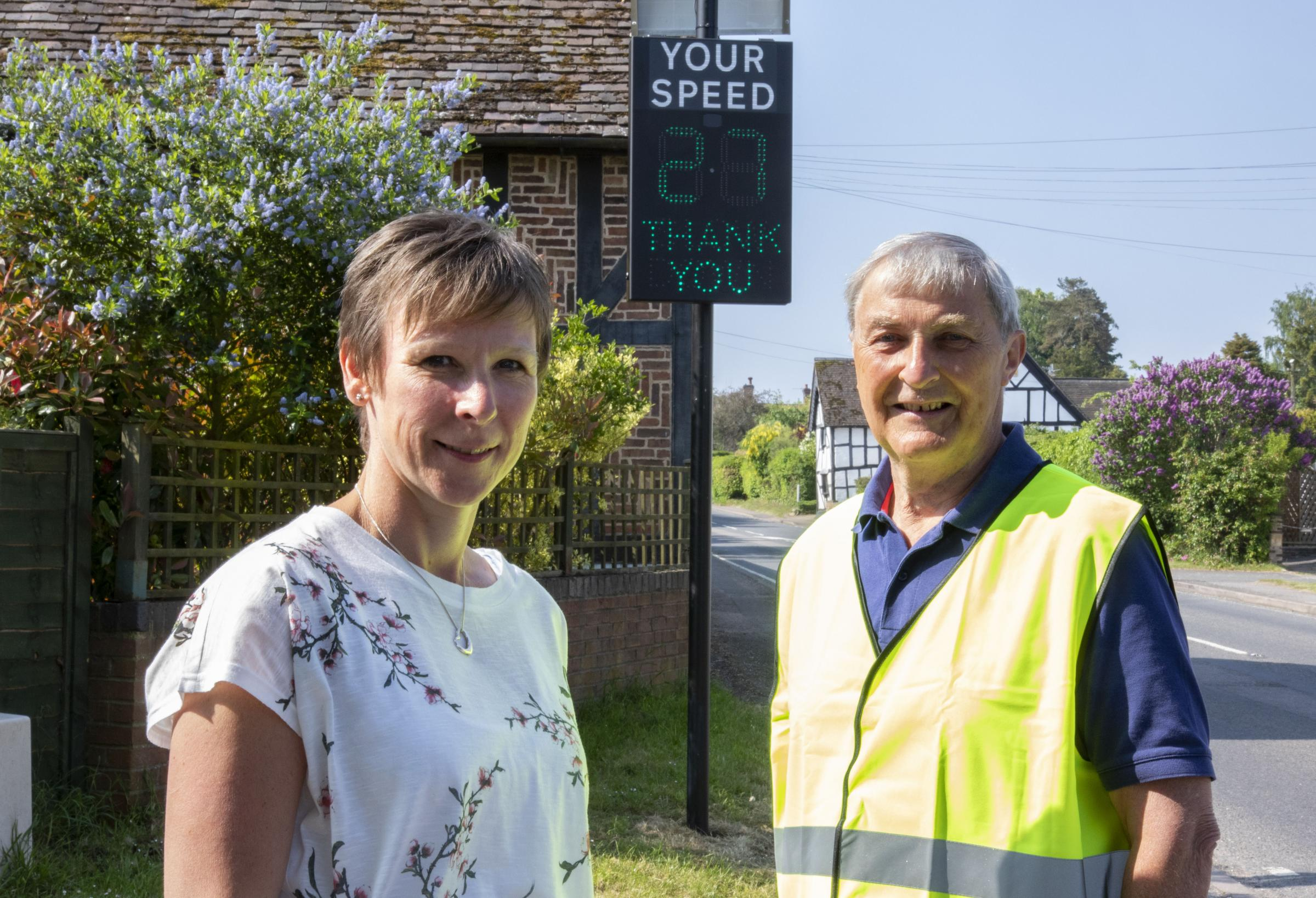 WN_210518_01 Paul Jackson 21.05.18 Norton - News speed activated sign. From left - Sue Drayton and Trevor Battersby, Norton and Lenchwick parish councillors..