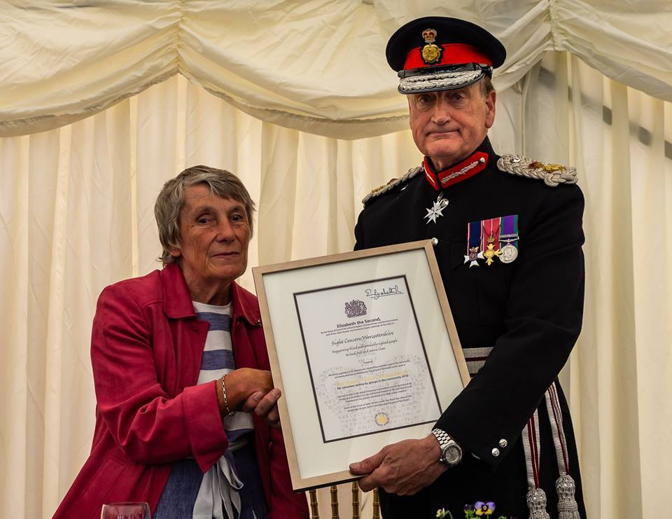 Volunteers at Sight Concern receive the Queen's Award for Voluntary Service