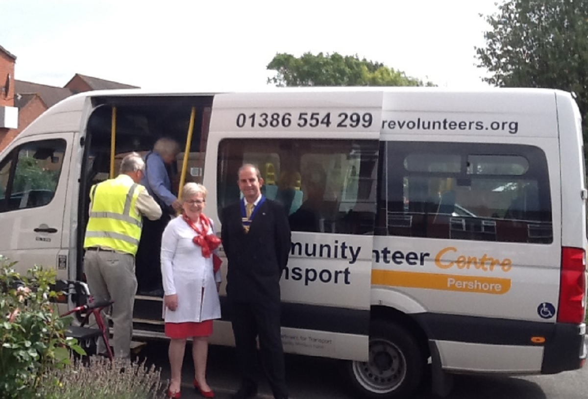 TRANSPORT: Kate Walton and Michael Williams pictured next to a Pershore Volunteer Centre vehicle