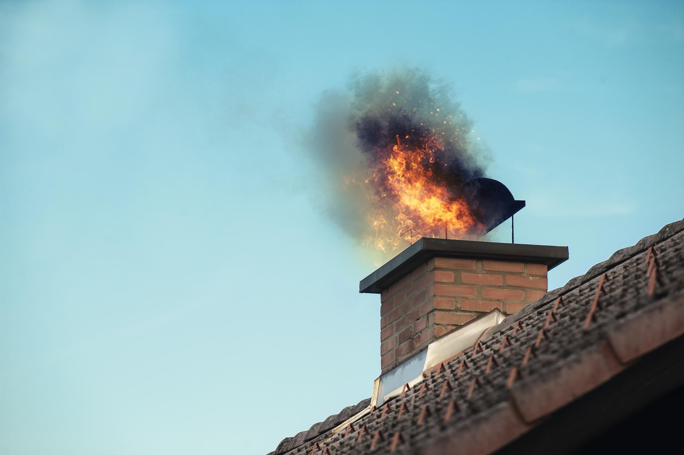 WARNING: A stock picture of a chimney with fire coming out. Credit: Getty Images