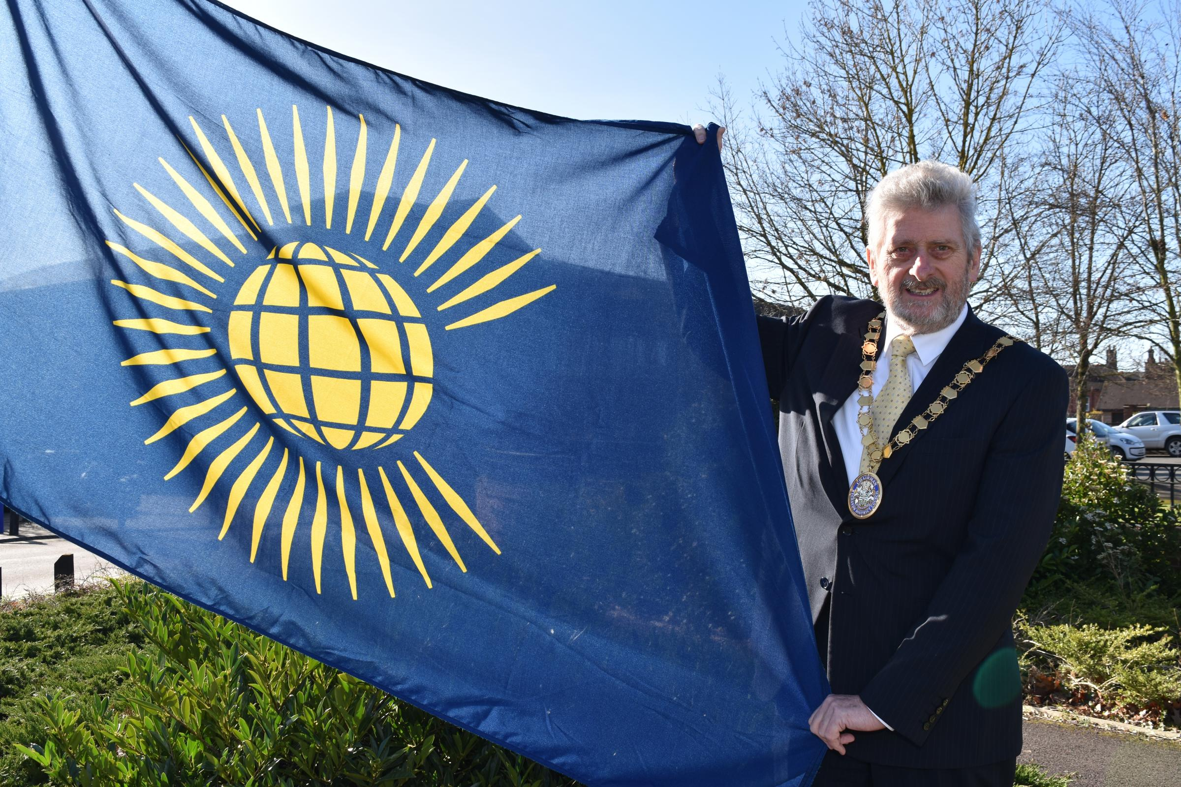 Cllr Tony Rowley, chairman of Wychavon District Council, flying the Commonwealth Flag outside the Civic Centre in Pershore