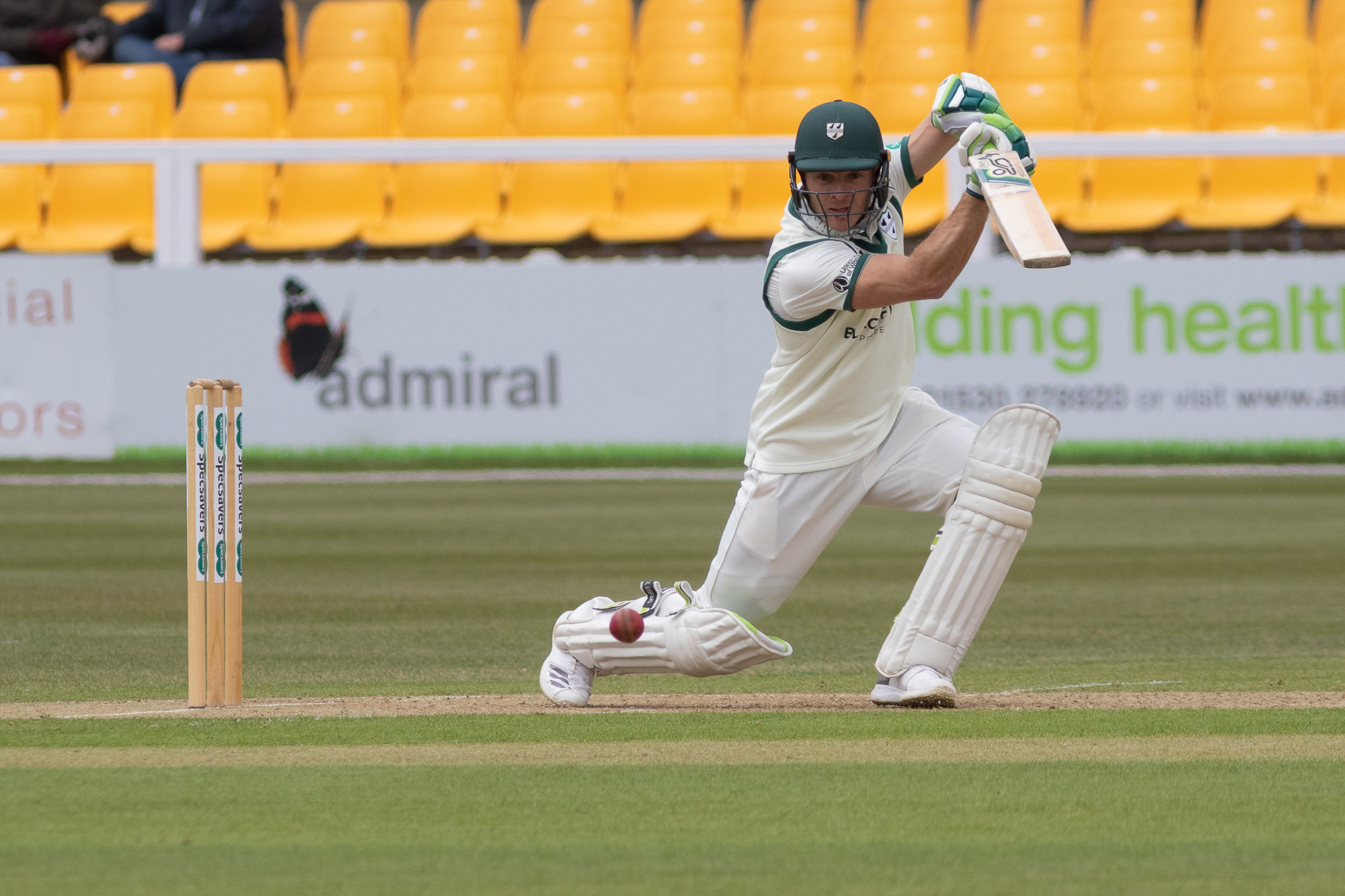 Captain Ben Cox drives for four on his way to 100 not out at Leicestershire. Picture: JOHN MALLETT